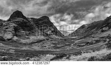 Epic Dramatic  Black And White Landscape Image Of Three Sisters In Glencoe In Scottish Highlands On
