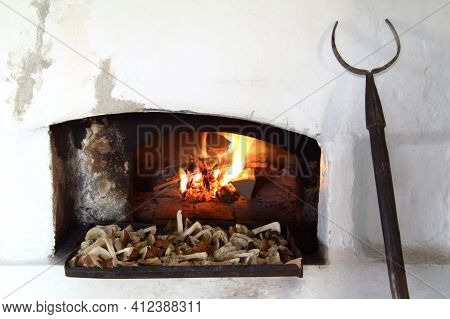 Drying White Mushrooms In A Large Russian Wood-burning Stove. Retro Style Cooking