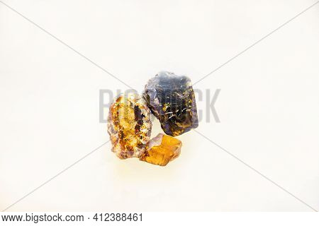 Raw Amber Of A Large Fraction Of Yellow Brown Color Scattered Isolated On A White Background, Fossil