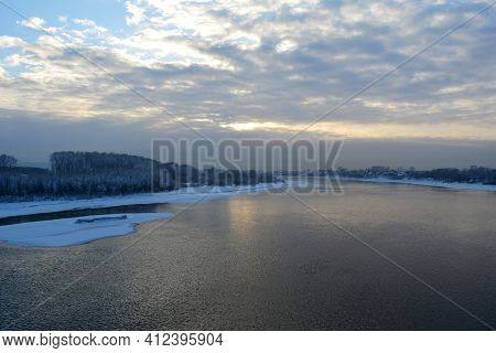 Beautiful Landscape With River Under Cloudy Sky In Winter
