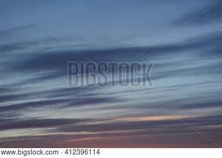 Striped Clouds In The Sky On The Sunset