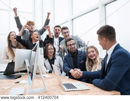 cheering business team applauding new business partners