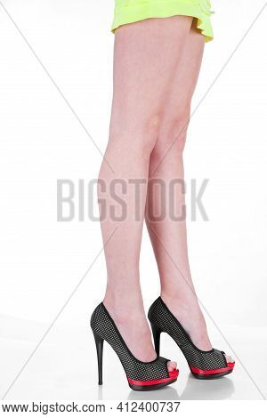 Female Fashion. Close-up High Heels Fashionable Shoes On Sexy Female Legs. Young Woman Standing Wear