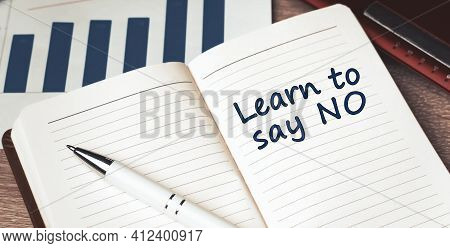The Words Learn To Say No Written On A White Notebook. Closeup Of A Personal Agenda