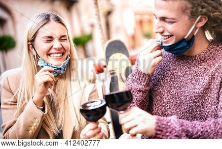Young Couple In Love Wearing Open Face Masks And Having Fun At Winery Bar Outdoors - Happy Hipster L
