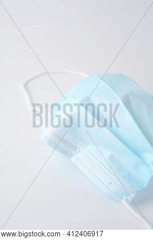 Blue Surgical Face Mask On White Background
