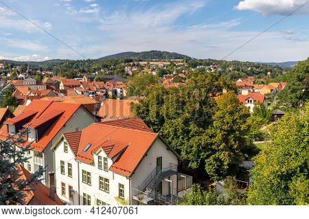 View Of The Red Roofs Of Schmalkalden, Thuringia From Above With Green Trees In The Foreground