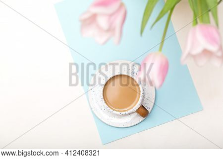 Coffee Mug And Flowers, Morning Coffee On White Table From Above, Cozy And Tasty Breakfast.