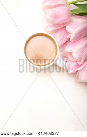 Coffee Mug With Pink Tulip Flowers On White Table Top View, Happy Morning Concept, Copy Space