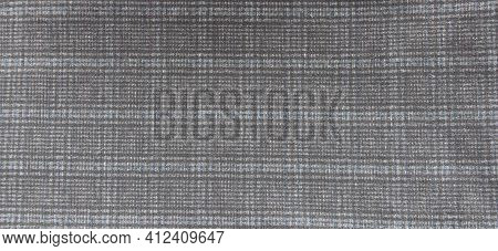 Tweed Fabric In A Cage Piece Of Material, A Full Frame Of Checkered Woolen Fabric In A Classic Patte
