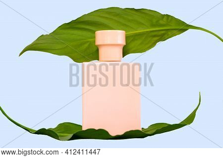 Pink Perfume Bottle And Plant Leaves. Isolated