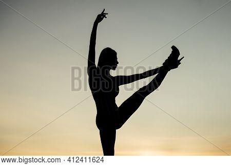 Ballet Dance Position. Woman Dance In Dark. Dark Figure Shape. Girl Dancing In Dusk