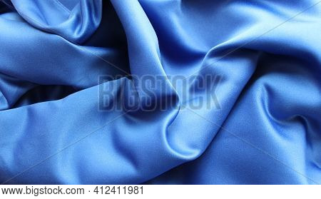 A Carelessly Crumpled Silk Fabric In Metallic Blue For An Elegant Look. Drapery With Smooth Curves A
