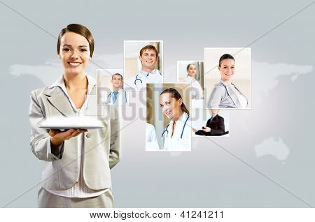 attractive woman holding a tablet pc and smiling