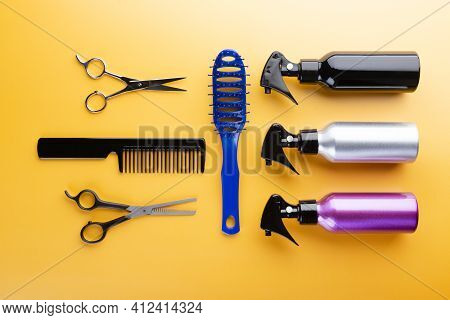 Hairdresser Set With Different Tools On Yellow Background. Professional Equipment For Haircut , Top