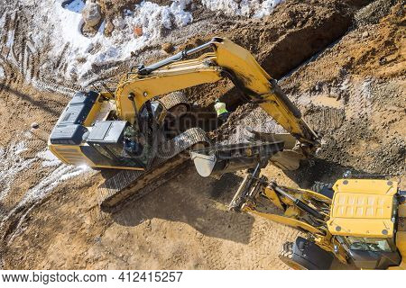 Construction Site A Huge Trench, Ditch For Drainage Canal Utility Pipe Pipeline Installation For Sto