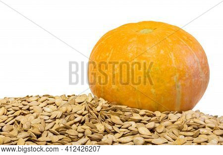 Orange Pumpkin And Its Seeds On An Isolated White Background. Healthy Vegetable Vegetarian Food. Clo