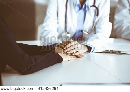 Unknown Woman-doctor Reassuring Female Patient, Close-up. Two Physicians Consulting And Giving Some