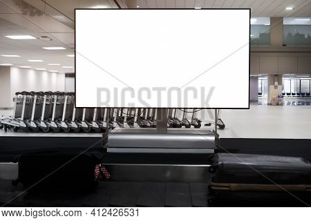 Lcd Blank Billboard At Conveyor Belt Luggage In Airport. Wide Screen For Cutomer Text Information Ad