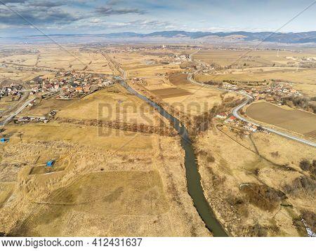 Curving Olt River Near Asphalt Road Aerial Drone View In Transylvania, Romania.