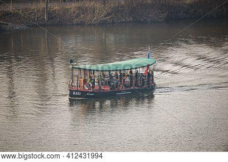Prague, Czech Republic - February 24, 2021. Retro Ferry Boat With Passengers Sailing On Moldau River