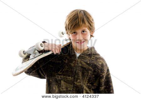 Portrait Of Smiling Boy Holding Skate