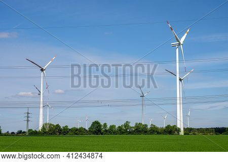 Wind Turbines And Power Lines Seen In Rural Germany