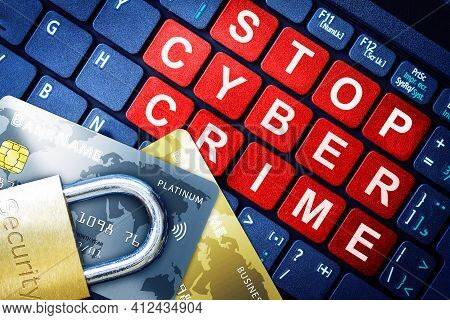 Stop Cyber Crime In Red Keys On High-tech Computer Keyboard Background With Security Engraved Lock O