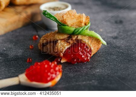 Pancakes With Caviar. Pancake Envelopes. Delicious Pancakes On The Table.