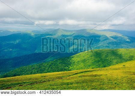 Path Through Mountain Meadow. Beautiful Carpathian Landscape In Summertime. Clouds On The Sky Above