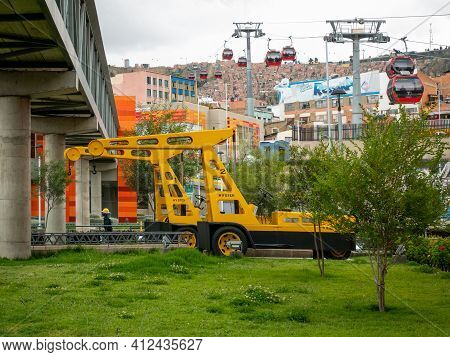 La Paz, Bolivia - February 11 2021: Antique Crane Painted Yellow Restored And Preserved As An Antiqu