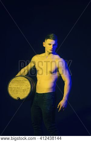 Viticulture Concept. Attractive Sexy Man With Wooden Barrel Of Wine Or Beer. Handsome Man Winemaker
