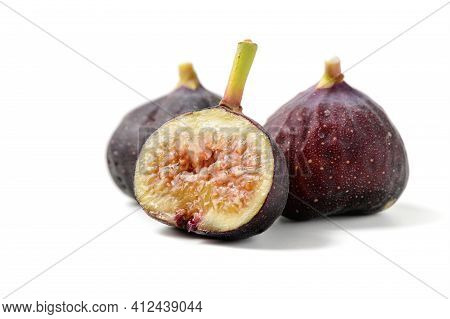 Fresh Purple Fig Fruit And Slices Isolated On White Background, Figs Are High In Calcium And Contain