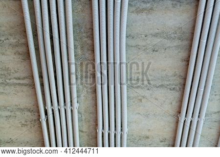 Rows Of Electrical Cables Laid In The Corrugates On The Ceiling. Wiring And Electrical Installation.