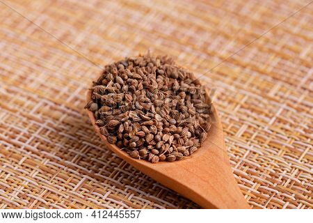Dried Anise Seasoning. Anise Seeds In A Wooden Spoon. A Spoon With Anise Collected In It.
