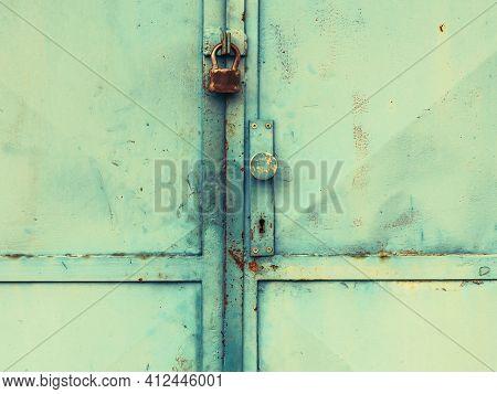 Vintage Industrial Metal Door Gate With Obsolete Locking System.  Old Green Painted Sheet Iron, Meta