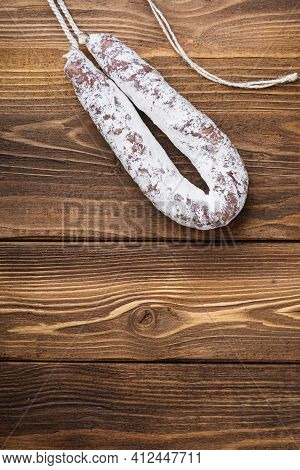 White Fermented Fuet Sausage On Wood Table With Space For Text.
