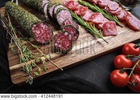 Spanish Fuet Salami Sausage Slices  On Balck Background.