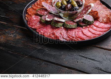 Cured Meat Platter Of Traditional Spanish Tapas. Chorizo, Salchichon, Longaniza And Fuet On Dark Woo