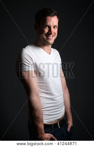 Young Man In Blue Jeans And White Shirt