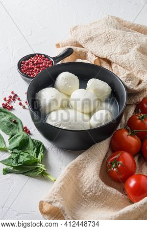 Mozzarella Buffalo In Black Bowl, Fresh Basil, Red Tomatoes And Olive Oil. Italian Cuisine, Healthy