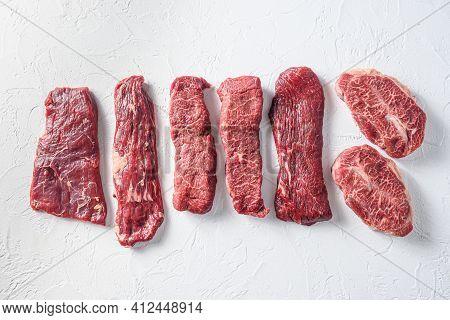 Set Of Denver, Top Blade,  Tri Tip Steak, Machete, Flank, Bavette London Broil  Marble  On White Bac