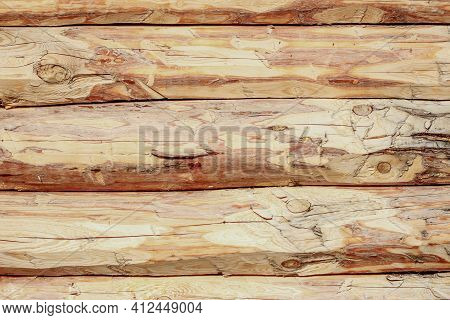 Log Wall Of A Wooden Hut As A Background