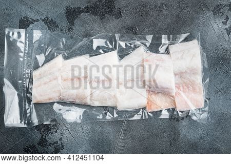 Haddock Fish Skinless In Vacuum Package, On Gray Background, Top View