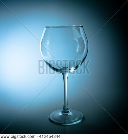 Empty Wine Glass With A High Leg In The Dark. Wine Glass. Glassware For Alcoholic Beverages. Glasswa