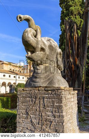 Rome, Italy - October 10, 2020: Giant Ancient Animal Head In 16th-century Garden, Cloister Of Michel