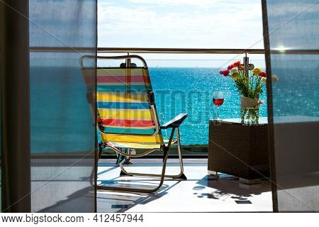 The Beautiful And Attracting Balcony View With Chaise Lounge And The Seaside Like An Ideal Holiday C
