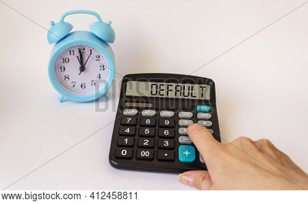 Default Calculator On Display Isolated On White Background, Near An Alarm Clock And A Female Hand