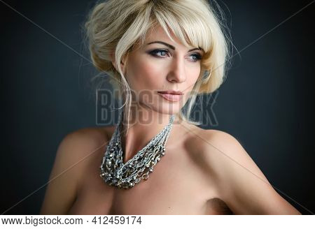 Adult Blonde Natural Beauty Woman With Hairdo And Necklace. Femininity Concept