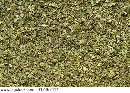 Pile Of Dried Green Oregano Texture Or Background Close-up Macro Shot.